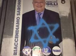 Atto vandalico contro i manifesti di Gilli