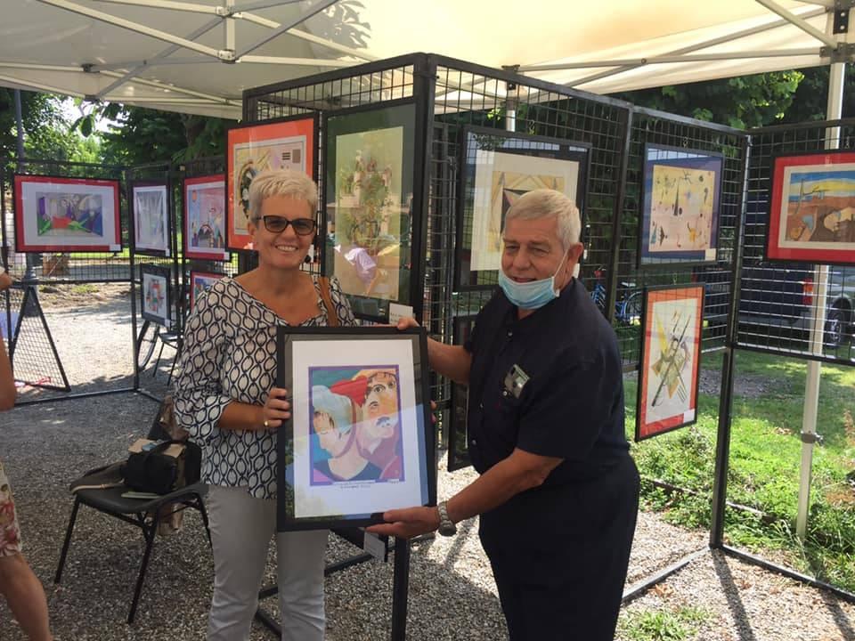 I quadri dell'assessore Favaron in beneficienza sul lungolago di Angera