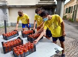 Caritas Ambrosiana, passata di pomodoro cooperativa Il Grigio
